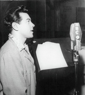 Recording one of his radio shows, 1952